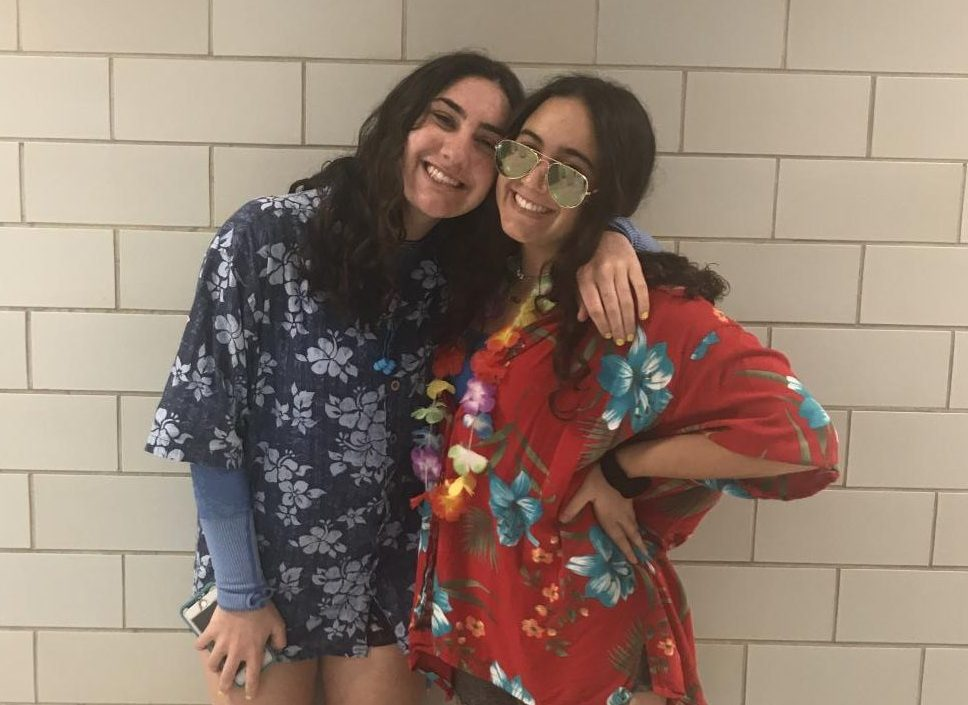 Juniors Lexie Finkelstein and Kaela Bernard sport Hawaiian-print shirts for a tropical theme.