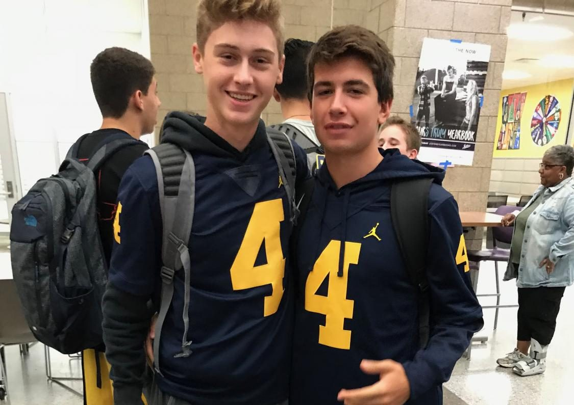 Juniors Dominick Cowdrey and Justin Satawa show off their matching University of Michigan football jerseys on Monsters University Day.