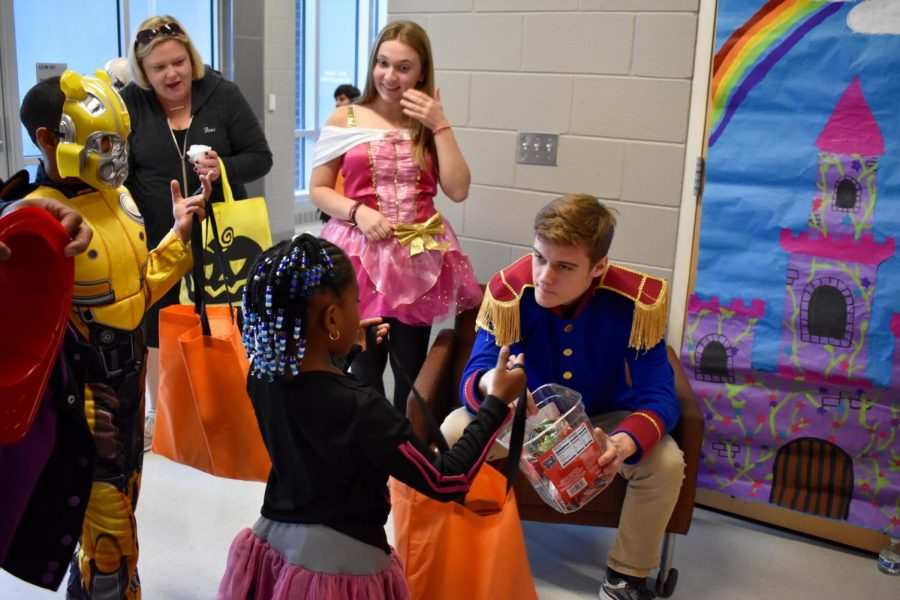 Riley Shapiro and Jackson Irmscher hand out candy.