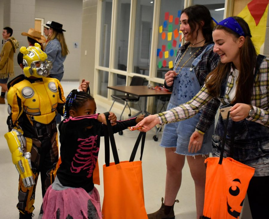 Meredith Parr and Lexie Finkelstein hand out candy as cowgirls.