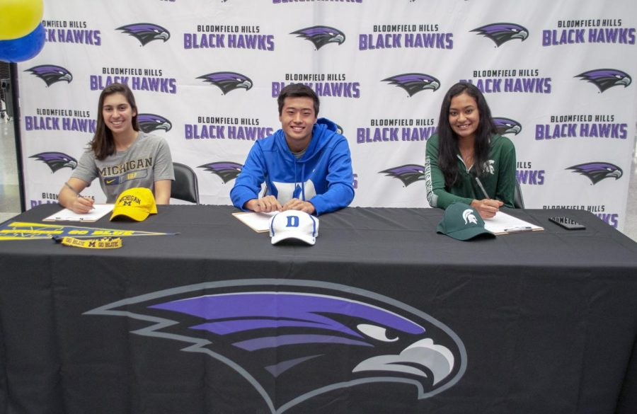 Mikaela, Andrew, and Tia signing their letters of intent