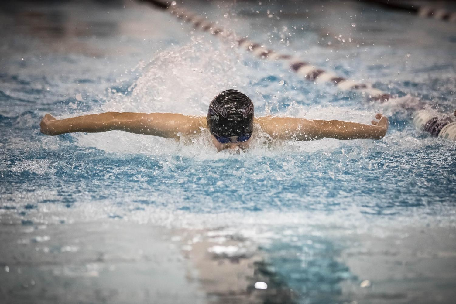 Junior Matthew Kowalski swimming the 100 meter breast stroke.