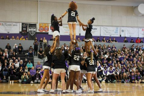 The cheerleaders perform their halftime show for the students.