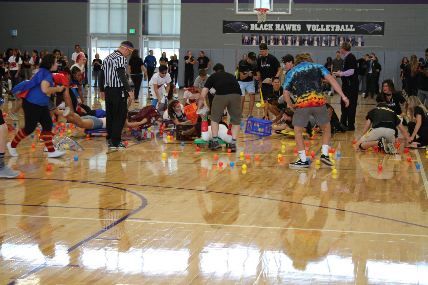 Freshmen, sophomores, juniors, and seniors compete in one of the many Black Hawks games, Human Hungry Hippos.