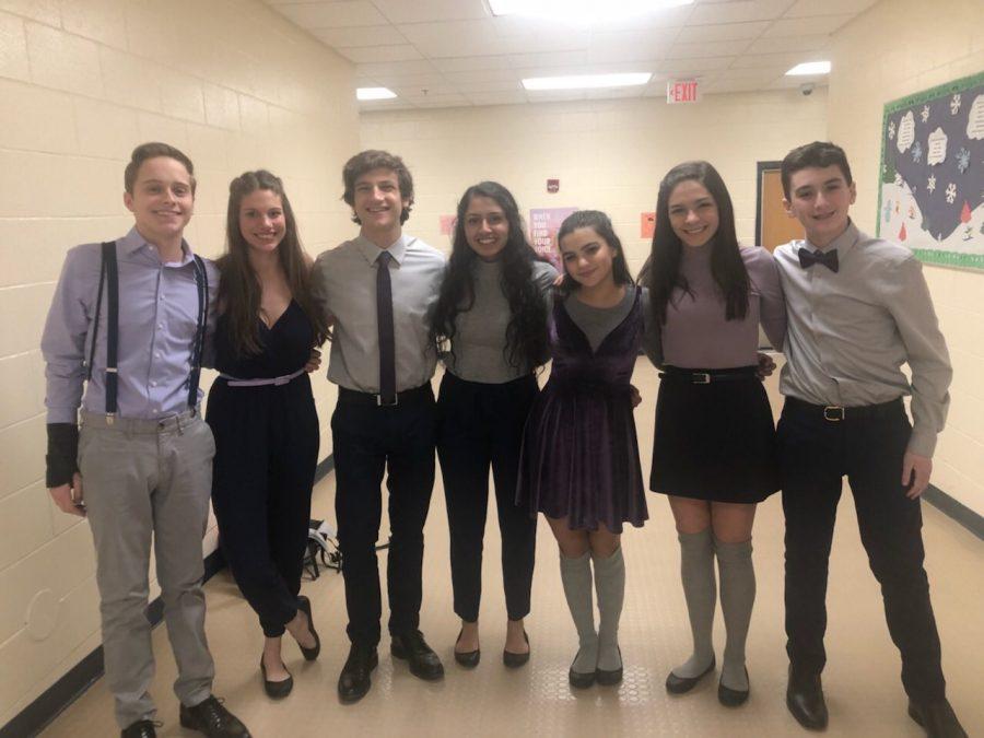 Victors pose in the hallways of Avondale High School after the invitational. Pictured left to right: Ethan Denk (12), Grace Jaksen, Connor Renusch (11), Tanya Bhardwaj (12), Joey Rankin (9), Mia Morelli (12), Ben Silberman (9).