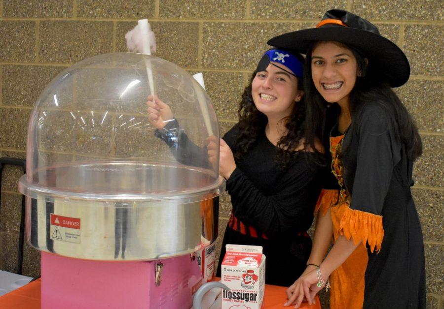Eva Goldman and Eeshika Dadheech run the cotton candy station.