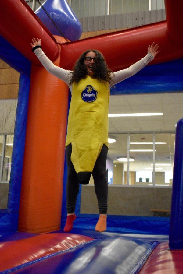 Rikki Goldman jumps around in the bouncy castle.