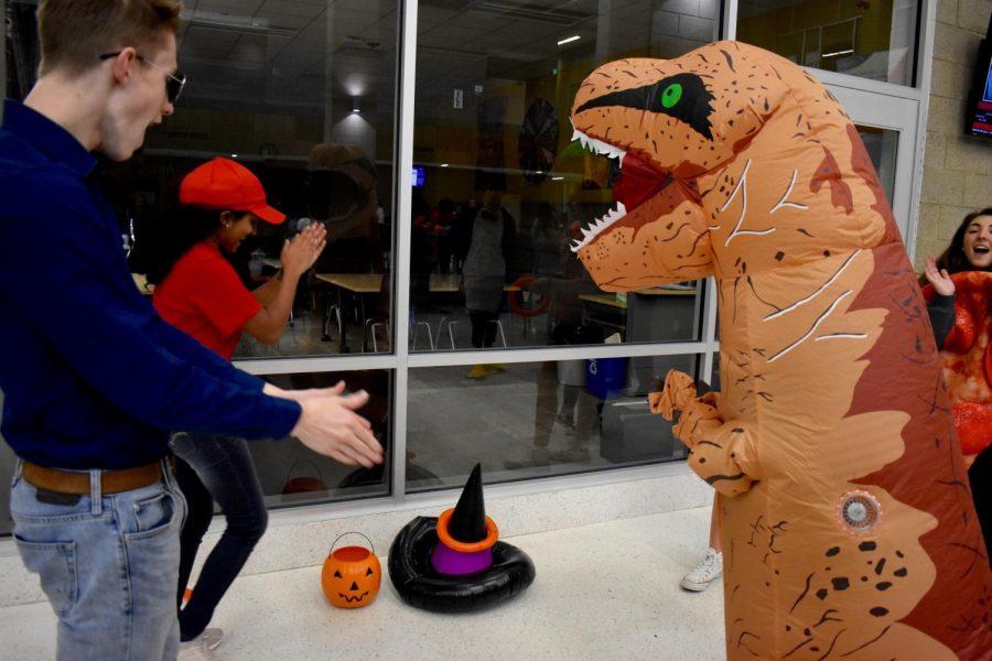 Ben Mutz cheers on a ring tossing T-Rex.
