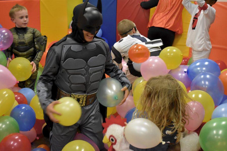 JP Arslanian plays in the balloon pit as Batman.