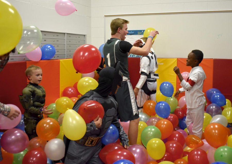 JP Arslanian, Andrew Zupancic, Brett Almany play in the balloon pit.