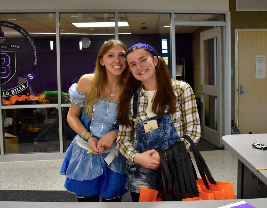 Kaitlyn Luckoff and Meredith Parr at the welcome desk.