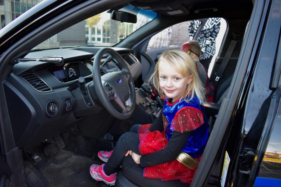 Kids explore the police car.