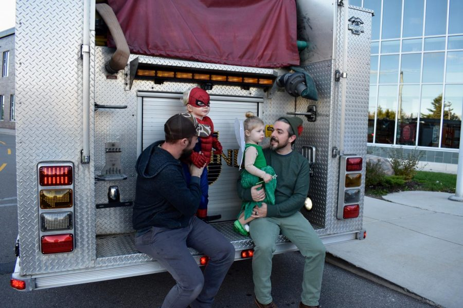 Mash-goers pose on the end of the fire truck.