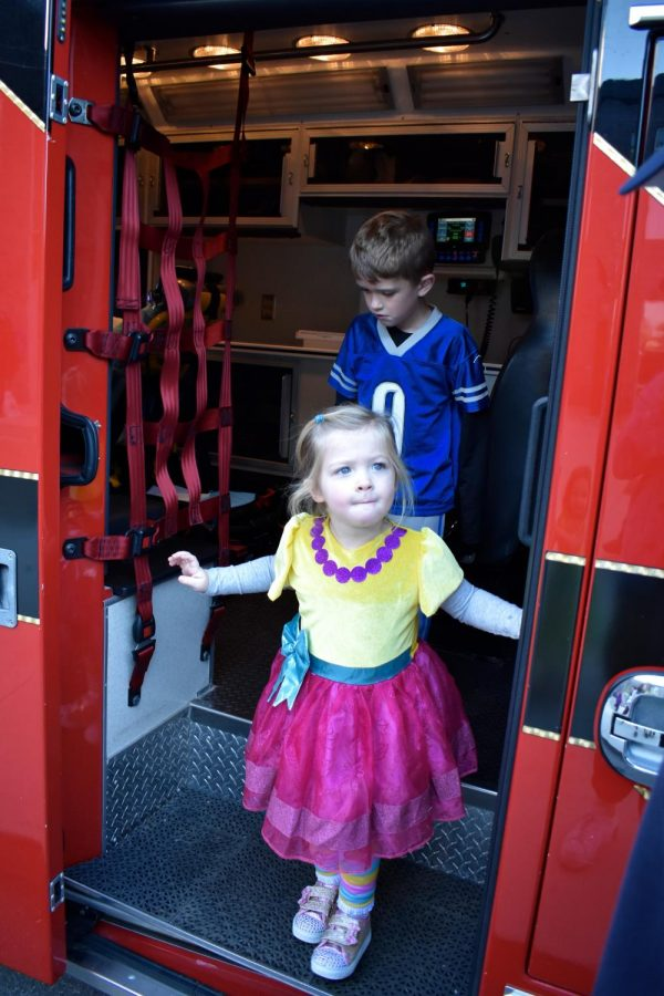 Christopher and Emmy Coffman exit an ambulance.