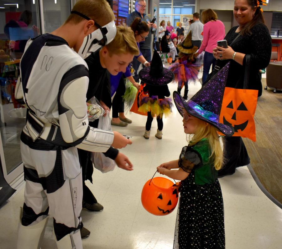 Andrew Zupancic and Ian Kerner hand out candy as Star Wars characters.