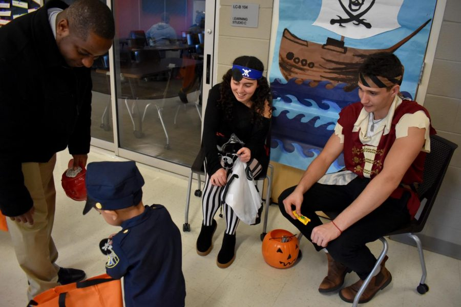Eva Goldman and Eli Levine hand out candy as pirates.
