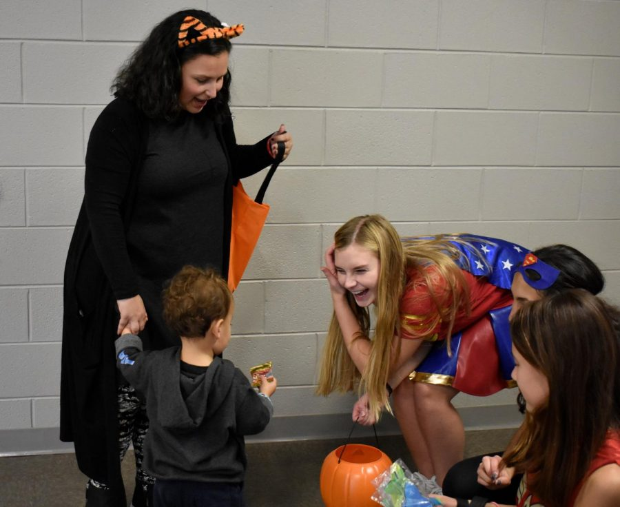 Isaac Matz and Ms. Matz get some candy from Kylie Sikatis.