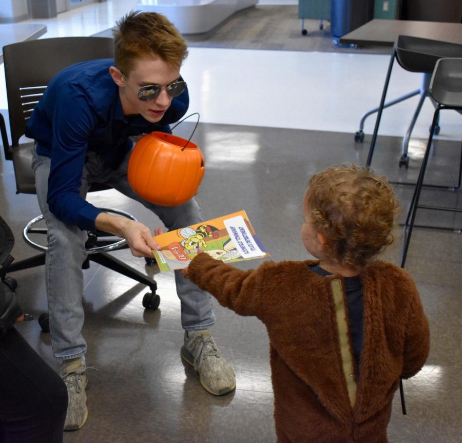 Ben Mutz hands out candy and other fun things as a police officer.