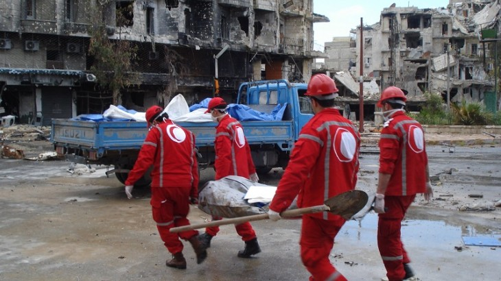 Image of the Red Cross aiding relief to damaged regions