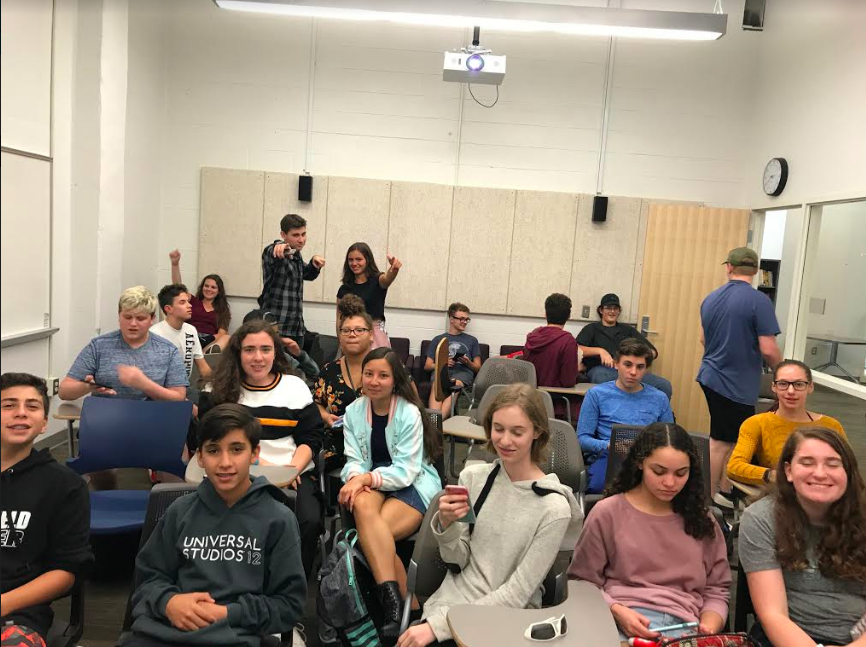 Students get ready to watch a movie at movie club