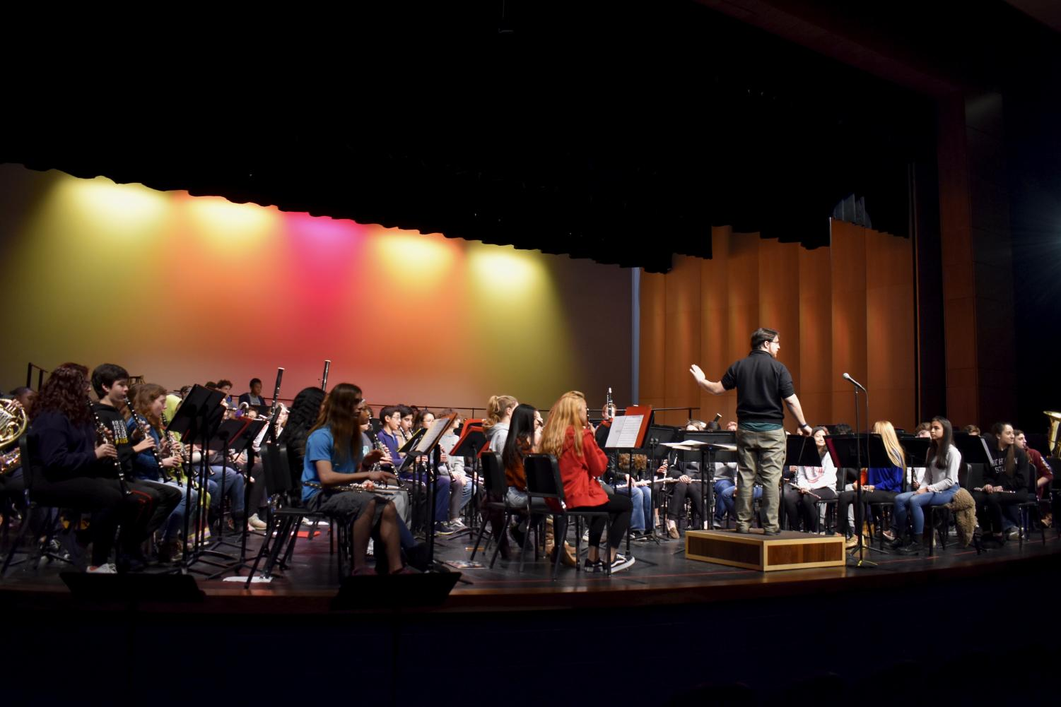 Teacher+Alan+Posner+conducts+the+band.%0A
