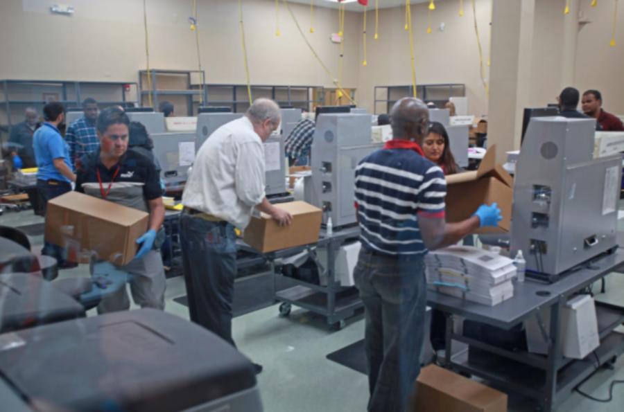 Volunteers working at ballot station