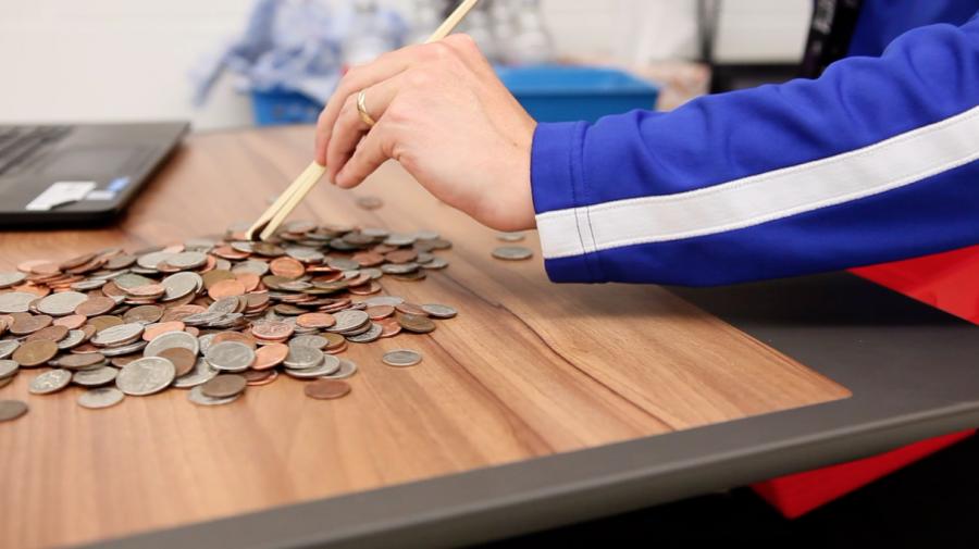 Teacher sorting through coins