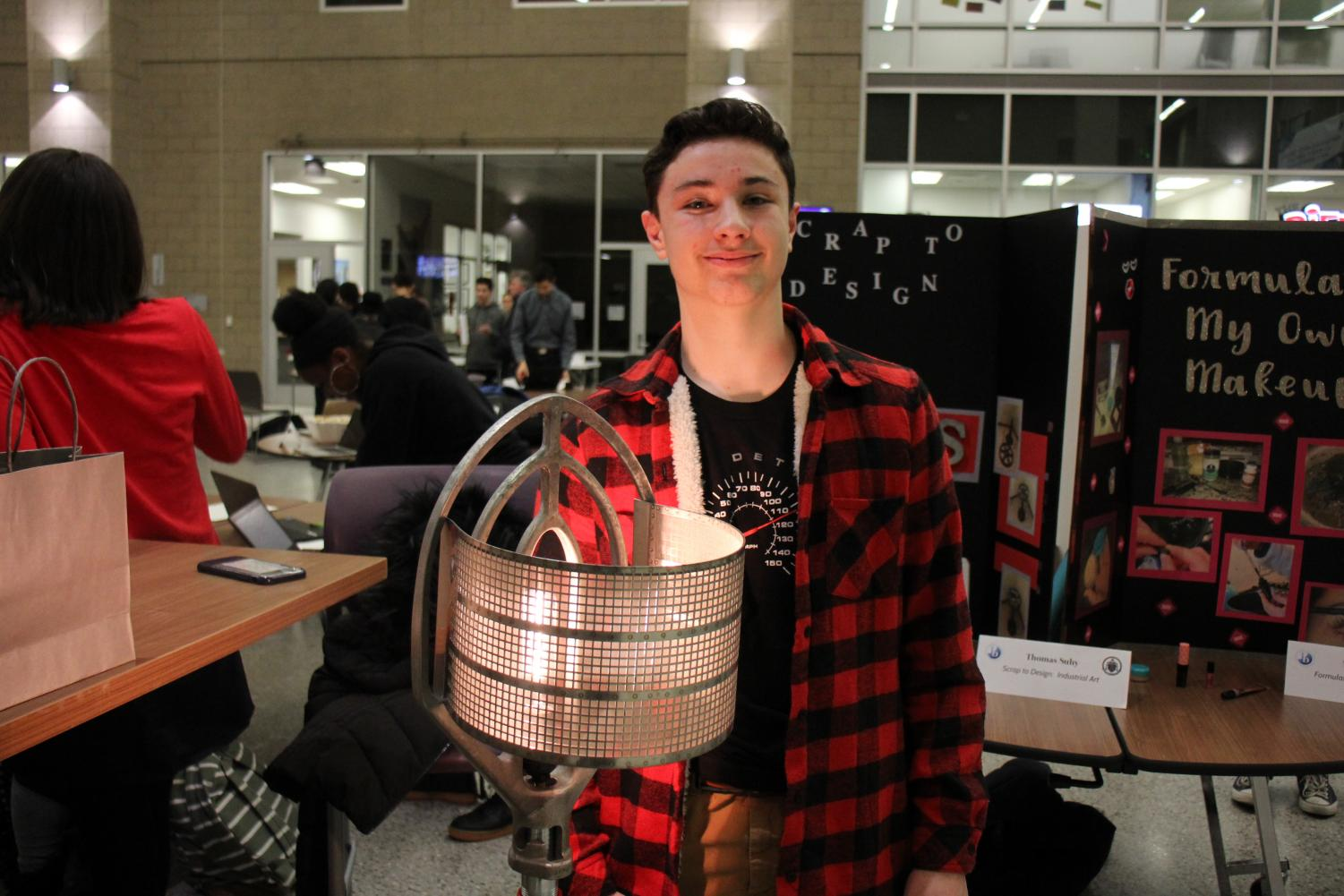 Student+poses+with+his+project+for+the+MYP+Celebration+Night.