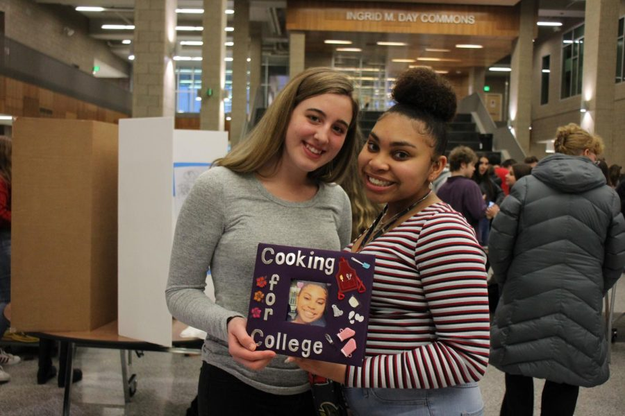 Students pose with a project during the MYP Celebration Night on Wednesday, February 13, 2019.