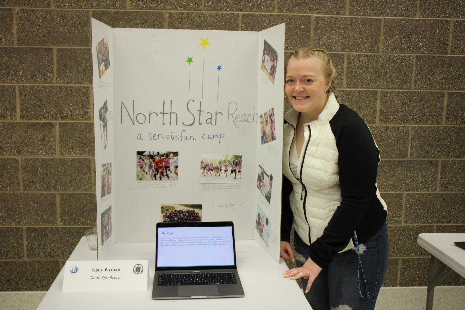 Kacy+Wyman+poses+with+her+%E2%80%9CNorth+Star+Reach%E2%80%9D+project+during+the+MYP+Celebration+Night.